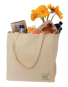 cotton canvas grocery tote filled with groceries and flowers