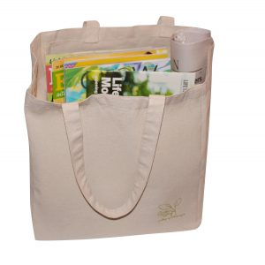 canvas tote bag filled with books and magazines