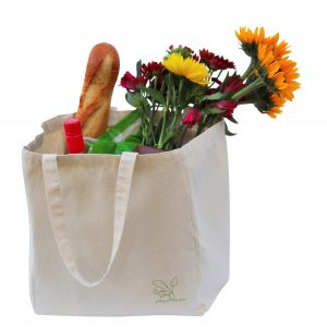 Canvas Bag filled with groceries and flowers from the market